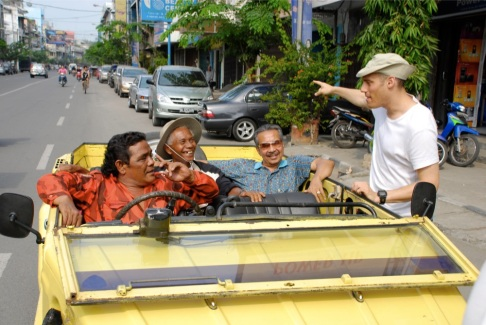 Behind-the-scenes shot of The Act of Killing, directed by Joshua Oppenheimer (far right). Pictured in car, left to right, Indonesian death squad members Safit Pardede, Anwar Congo and Adi Zulkadry.