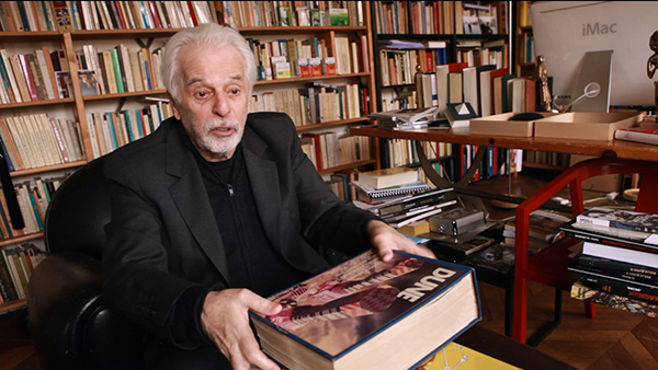 Alejandro Jodorowsky, seen here with the totemic book of storyboards for Dune
